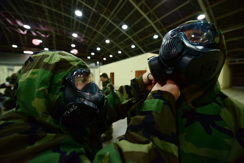 Airmen don M50 gas masks during Ability to Survive and Operate training May 24, 2019, at Incirlik Air Base, Turkey. The M50 gas mask is designed to protect against chemical, biological and radiological environments. (U.S. Air Force photo by Tech. Sgt. Jim Araos)