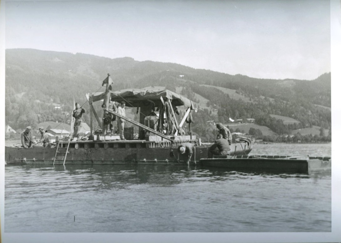 U.S. Army Engineers conduct diving operations to recover Nazi cryptologic records from Lake Schlersee in Southern Germany at the end of World War II
