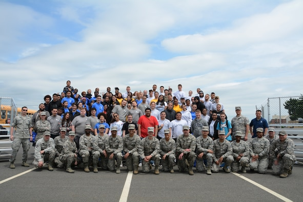 Airmen from the 439th Airlift Wing and students from local high schools pose for a group photo at the conclusion of the 2019 Youth Outreach Day on May 23, at Westover Air Reserve Base, Mass. Youth Outreach day is an annual event put on by the 439th Airlift Wing that ensures a close connection is kept between Westover and the greater community. (U.S. Air Force photo by Senior Airman Hanna Smith)