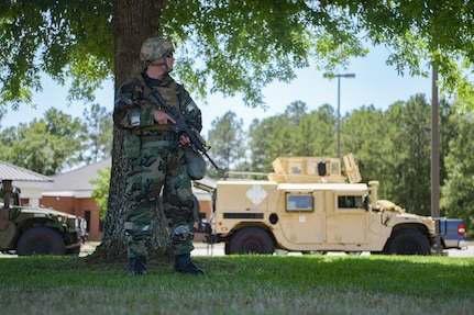 Staff Sgt. Matthew Guggenbiller, a patrolman assigned to the 628th Security Forces Squadron, helps establish a perimeter during exercise Palmetto Challenge May 21, 2019, at McEntire Air National Guard Base, S.C.