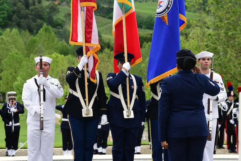 Master Sgt. Tamieka Morgan, 31st Fighter Wing executive assistant to the command chief, salutes as a joint service color guard presents the colors at the Florence American Cemetery Memorial Day event in Florence, Italy on May 27, 2019. The 31st Fighter Wing represented the U.S. Air Force by sending a formation of Airmen. (U.S. Air Force photo by Airman 1st Class Caleb House)