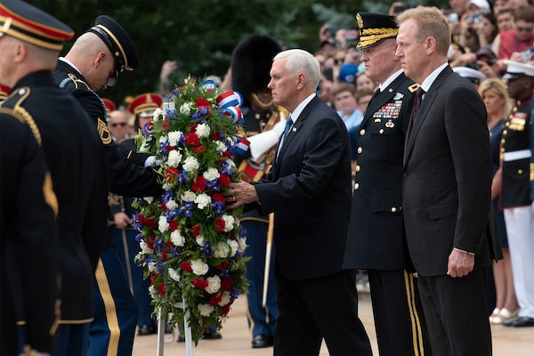 Vice President Mike Pence lays a wreath at the Tomb of the Unknown Soldier with Acting Defense Secretary Patrick M. Shanahan and Army Maj. Gen. Michael L. Howard at Arlington National Cemetery, Va., May 27, 2019.