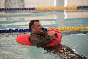 Airman training in swimming pool.