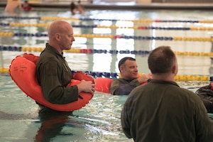 Airmen training in swimming pool.