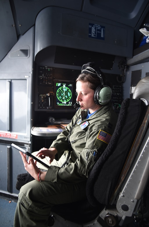 Capt. Julie Fantaske, 53rd Weather Reconnaissance Squadron navigator, checks her inflight publications on her tablet on a flight from Brunswick, Georgia to Keesler Air Force Base, Mississippi, May 10, 2019.  Navigators are responsible for preparing flight plans, which include routes, headings, checkpoints, and times. During flight, they operate from their station using equipment such as GPS, radio, and radar systems that assists in guiding the aircraft through weather. (U.S. Air Force photo by Tech. Sgt. Christopher Carranza)