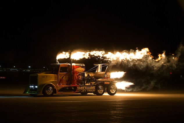 Chris Darnell, driver of the Shockwave Jet Truck, drives down the Marine Corps Air Station(MCAS) Yuma, Ariz., flight line during the 2019 Yuma Airshow March 8, 2019. The Flash Fire Jet Trucks are the world's fastest jet-powered trucks achieving a record 375 miles per hour. The airshow is MCAS Yuma's only military airshow of the year and provides the community an opportunity to see thrilling aerial and ground performers for free while interacting with Marines and Sailors. (U.S. Marine Corps photo ny Pfc. Hall)