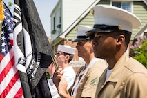 U.S. Marines with 2nd Marine Logistics Group, 2nd Marine Division, present the colors during a Memorial Day parade as part of Fleet Week New York (FWNY), in Queens, N.Y., May 26, 2019. FWNY is an opportunity for the citizens of New York City and the surrounding tristate area to come together with the nation's sea services through community engagement to gain a better understanding of how the sea services support the national defense of the United States. (U.S. Marine Corps photo by Cpl. Tojyea G. Matally)