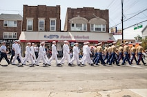 U.S. Marines, sailors, and Coast Guard members march in a Memorial Day parade as part of Fleet Week New York (FWNY), in Queens, N.Y., May 26, 2019. FWNY is an opportunity for the citizens of New York City and the surrounding tristate area to come together with the nation's sea services through community engagement to gain a better understanding of how the sea services support the national defense of the United States. (U.S. Marine Corps photo by Cpl. Tojyea G. Matally)