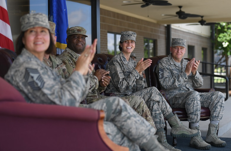 "Keesler leadership applauds during a drill performance at the Levitow Training Support Facility drill pad on Keesler Air Force Base, Mississippi, May 21, 2019. The Keesler drill teams, made up of Airmen from various squadrons within the 81st Training Group, debuted their performances in front of base leadership and their peers. Every year, both the regulation and freestyle teams compete at Lackland Air Force Base, Texas, for ""Best Technical Training Drill Team of the Year."" However, this year it was cancelled due to inclement weather. (U.S. Air Force photo by Kemberly Groue)"