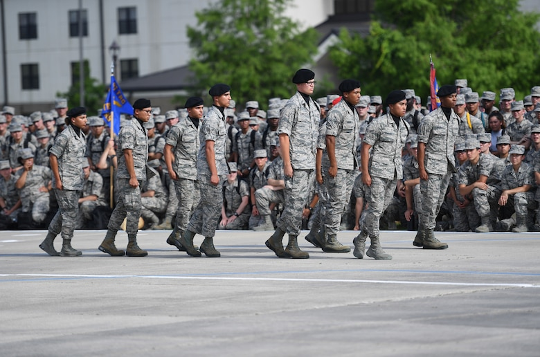 "The Keesler Air Force Base regulation drill team performs their routine at the Levitow Training Support Facility drill pad on Keesler Air Force Base, Mississippi, May 21, 2019. The drill teams, made up of Airmen from various squadrons within the 81st Training Group, debuted their performances in front of base leadership and their peers. Every year both the regulation and freestyle teams compete at Lackland Air Force Base, Texas, for ""Best Technical Training Drill Team of the Year."" However, this year it was cancelled due to inclement weather. (U.S. Air Force photo by Kemberly Groue)"