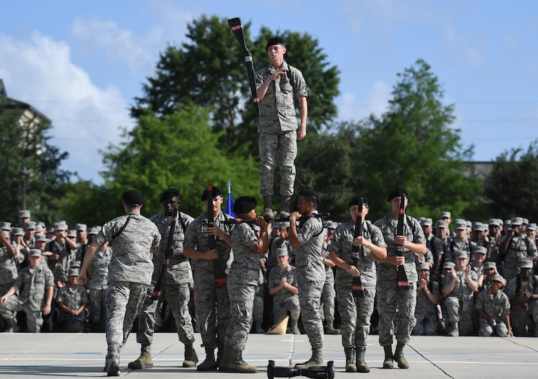 "The Keesler Air Force Base freestyle drill team performs their routine at the Levitow Training Support Facility drill pad on Keesler Air Force Base, Mississippi, May 21, 2019. The drill teams, made up of Airmen from various squadrons within the 81st Training Group, debuted their performances in front of base leadership and their peers. Every year both the regulation and freestyle teams compete at Lackland Air Force Base, Texas, for ""Best Technical Training Drill Team of the Year."" However, this year it was cancelled due to inclement weather. (U.S. Air Force photo by Kemberly Groue)"