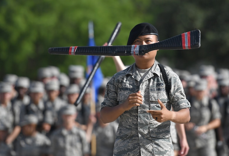 "U.S. Air Force Airman David Templonuevo, 335th Training Squadron student, spins a rifle during a freestyle drill performance at the Levitow Training Support Facility drill pad on Keesler Air Force Base, Mississippi, May 21, 2019. The Keesler AFB drill teams, made up of Airmen from various squadrons within the 81st Training Group, debuted their performances in front of base leadership and their peers. Every year both the regulation and freestyle teams compete at Lackland Air Force Base, Texas, for ""Best Technical Training Drill Team of the Year."" However, this year it was cancelled due to inclement weather. (U.S. Air Force photo by Kemberly Groue)"