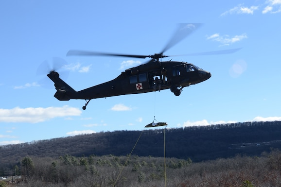 FORT INDIANTOWN GAP, Pa.-Soldiers training at the Pennsylvania National Guard's Medical Battalion Training Site's 68W requalification course medevac a simulated casualty during their capstone exercise Feb. 26. (U.S. Army National Guard photo by Maj. Angela King-Sweigart\Released)