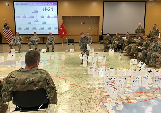 New York Air National Guard Lt. Col. Tammy Street, center, commander of the logistics readiness squadron of the 109th Airlift Wing, moves a placard representation of a wing response element during the rehearsal of New York military forces plan for a coastal storm during the 2019 hurricane season at the Armed Forces Reserve Center in New Windsor, N.Y., May 23, 2019.