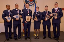 Airmen were honored with awards during the Airman Leadership School Graduation Ceremony May 23, 2019, at Joint Base Charleston, S.C. (Left to right) Senior Airman Steffon Capel, 315th Aeromedical Evacuation Squadron, received the Distinguished Graduate award; Senior Airman Christopher Leung, 437th Operations Support Squadron, received the Distinguished Graduate award; Staff Sgt. Ryan Erb, 437th Aircraft Maintenance Squadron, received the John L. Levitow award; Staff Sgt. Tenley Long, 628th Public Affairs, received the Commandants award; Senior Airman Shadi Zahed, 628th Force Support Squadron, received the Academic Achievement award and Senior Airman Christian Voytko,16th Airlift Squadron, received the Distinguished Graduate award.