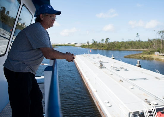 Ricky Boudreaux, captain of the Rhonda Lamulle looks over at a fuel barge May 21, 2019, at Tyndall Air Force Base, Florida.