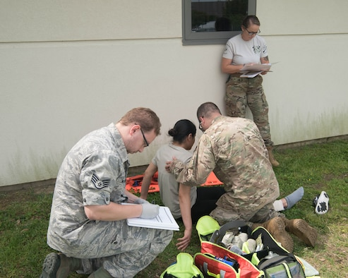 A member of the 633d Medical Group evaluates participants in the emergency medical technician course during a hands-on portion of their EMT recertification training on Joint Base Langley-Eustis, Virginia, May 17, 2019. Members who were trying to get recertified had to go through a week-long program which incorporated both classroom lecture, hands-on training and a written test. (U.S. Air Force photo by Airman 1st Class Marcus M. Bullock)