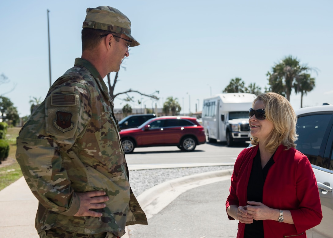 U.S. Air Force Col. Brent Hyden (left), Tyndall Program Management Office director, speaks with Marilyn M. Thomas, Headquarters U.S. Air Force Principal Deputy Assistant Secretary for Financial Management and Comptroller, May 22, 2019, at Tyndall Air Force Base, Florida.