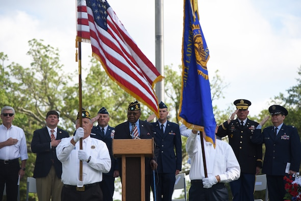 Retired U.S. Air Force Chief Master Sgt. Chris Moore sings the national anthem during the Biloxi National Cemetery Memorial Day Ceremony in Biloxi, Mississippi, May 27, 2019. The ceremony honored those who have made the ultimate sacrifice while serving in the armed forces. Biloxi National Cemetery is the final resting place of more than 23,000 veterans and their family members. Eight hundred burials take place there every year for men and women who served in wars years ago and for those defending America today. (U.S. Air Force photo by Kemberly Groue)