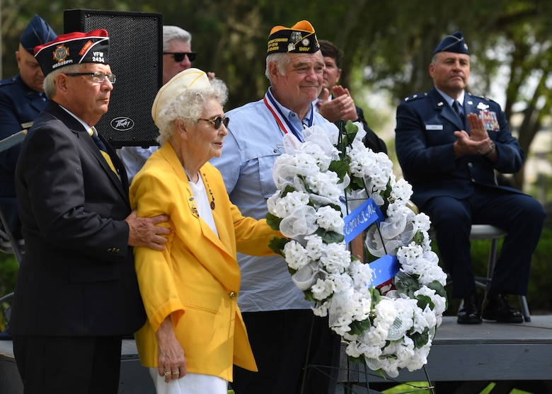 Emily Crower, spouse of retired U.S. Army Maj. Albert Crower, presents a wreath on behalf of the Gold Star Wives organization during the Biloxi National Cemetery Memorial Day Ceremony in Biloxi, Mississippi, May 27, 2019. The ceremony honored those who have made the ultimate sacrifice while serving in the armed forces. Biloxi National Cemetery is the final resting place of more than 23,000 veterans and their family members. Eight hundred burials take place there every year for men and women who served in wars years ago and for those defending America today. (U.S. Air Force photo by Kemberly Groue)