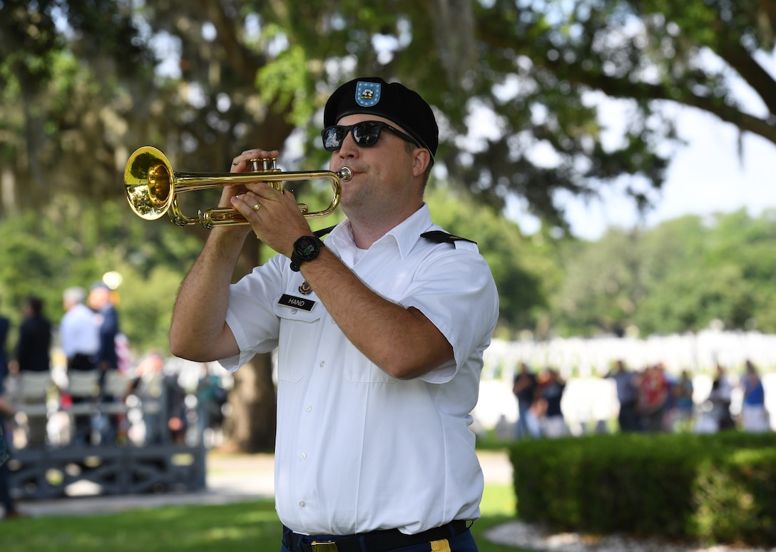 U.S. Army Sgt. Patrick Hand, 41st Army Band, Jackson, Mississippi, plays Taps during the Biloxi National Cemetery Memorial Day Ceremony in Biloxi, Mississippi, May 27, 2019. The ceremony honored those who have made the ultimate sacrifice while serving in the armed forces. Biloxi National Cemetery is the final resting place of more than 23,000 veterans and their family members. Eight hundred burials take place there every year for men and women who served in wars years ago and for those defending America today. (U.S. Air Force photo by Kemberly Groue)
