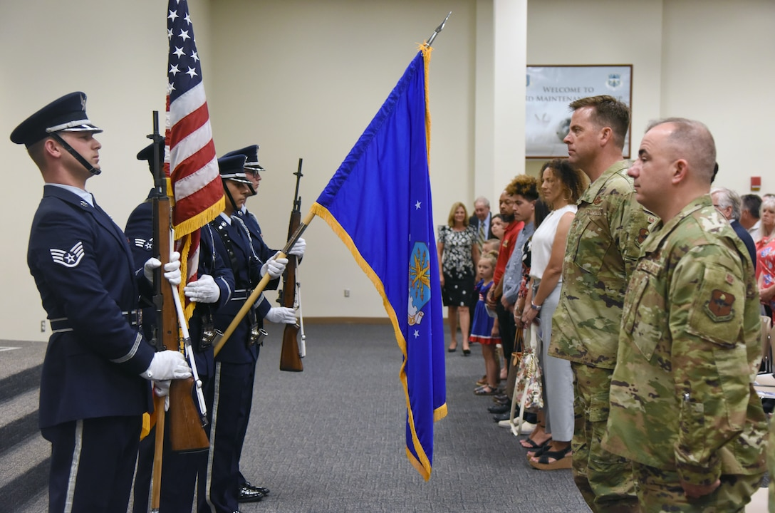The Keesler Honor Guard presents the colors during the 334th Training Squadron change of command ceremony in the Roberts Consolidated Aircraft Maintenance Facility at Keesler Air Force Base, Mississippi, May 23, 2019. U.S. Air Force Lt. Col. Harry James, incoming 334th TRS commander, assumed command from Lt. Col. Billy Wilson, Jr., outgoing 334th TRS commander, with the passing of the guidon. The passing of the guidon is a ceremonial symbol of exchanging command from one commander to another. (U.S. Air Force photo by Kemberly Groue)