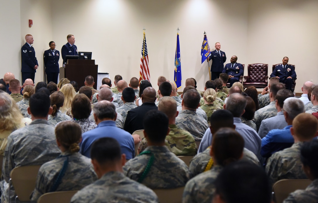 U.S. Air Force Lt. Col. Harry James, incoming 334th Training Squadron commander, delivers remarks during the 334th TRS change of command ceremony in the Roberts Consolidated Aircraft Maintenance Facility at Keesler Air Force Base, Mississippi, May 23, 2019. Prior to becoming the 334th TRS commander, James worked within the same squadron as the director of operations. (U.S. Air Force photo by Kemberly Groue)