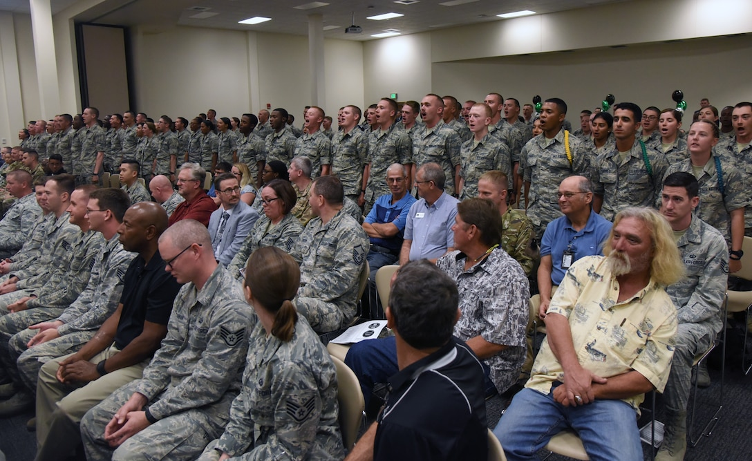 Airmen from the 334th Training Squadron recites the squadron's chant during the 334th TRS change of command ceremony in the Roberts Consolidated Aircraft Maintenance Facility at Keesler Air Force Base, Mississippi, May 23, 2019. U.S. Air Force Lt. Col. Harry James, incoming 334th TRS commander, assumed command from Lt. Col. Billy Wilson, Jr., outgoing 334th TRS commander, with the passing of the guidon. The passing of the guidon is a ceremonial symbol of exchanging command from one commander to another. (U.S. Air Force photo by Kemberly Groue)