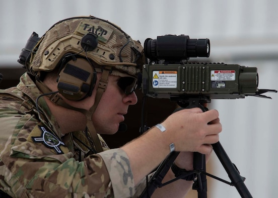 Tech. Sgt. Justin Geiger, 66th Weapons School (WPS) Joint Terminal Attack Controller (JTAC) instructor, looks through a Type 163 Laser target designator on the Nevada Test and Training Range (NTTR), Nev., May 15, 2019. JTACs used the laser to compete against each other to see who could most accurately drop inert bombs on a target during Gunsmoke. (U.S. Air Force photo by Airman 1st Class Bryan Guthrie)