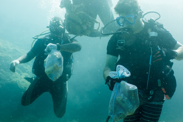 Divers look for trash during a scuba beach cleanup May 26, 2019 at Sunabe North Steps, Okinawa, Japan.