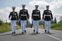 U.S. Marines with Marine Forces Europe and Africa walk to the wreath-laying ceremony at the German World War I cemetery near Belleau, France, May 26, 2019.