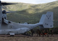 U.S. Marines with Special Purpose Marine Air-Ground Task Force-Crisis Response-Africa 19.2, Marine Forces Europe and Africa, and members of the Italian military load a simulated casualty onto a U.S. Marine Corps MV-22B Osprey during a joint tactical recovery of aircraft and personnel rehearsal during exercise Joint Stars 2019 in Capo Teulada, Sardinia, Italy, May 27, 2019.