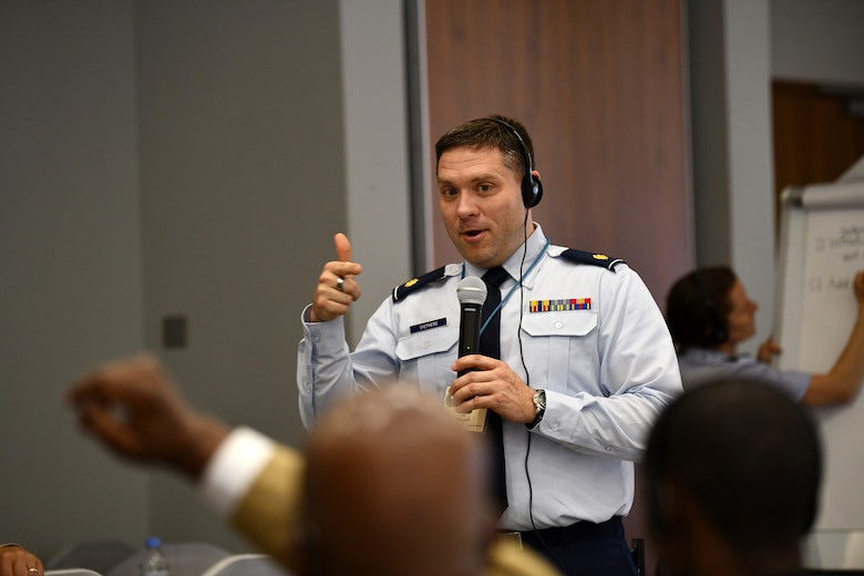 U.S. Air Force Maj. John Shepherd, a public health officer, facilitates discussions for one of the break out groups during the African Partner Outbreak Response Alliance (APORA) conference in Kigali, Rwanda on May 21, 2019. These break out groups focused on various subjects to include early warning and surveillance measures, logistical planning and preparedness. During APORA, military and civilian leaders worked together to align best practices and improve response capabilities for potential outbreaks of contagious diseases. The training helped bolster relationships with current partners and mobilize new partners to strengthen pandemic prevention programs. (U.S. Air Force photo by Master Sgt. Andy M. Kin)