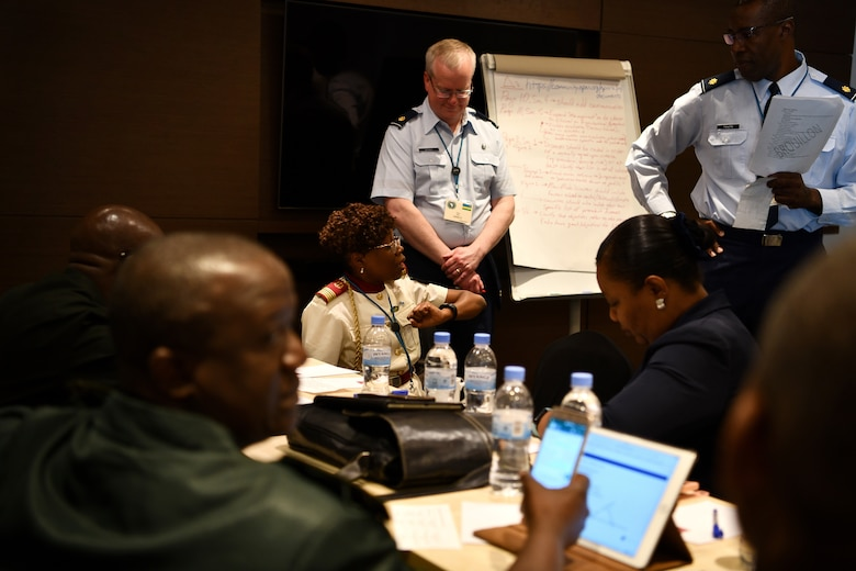 U.S. Air Force Maj. Malick Traore, an international health specialist, advances discussions for one of the break out groups during the African Partner Outbreak Response Alliance (APORA) conference in Kigali, Rwanda on May 21, 2019. These break out groups focused on various subjects to include early warning and surveillance measures, logistical planning and preparedness. During APORA, military and civilian leaders worked together to align best practices and improve response capabilities for potential outbreaks of contagious diseases. The training helped bolster relationships with current partners and mobilize new partners to strengthen pandemic prevention programs. (U.S. Air Force photo by Master Sgt. Andy M. Kin)