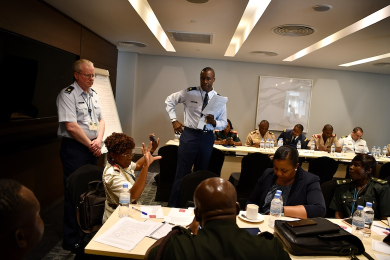U.S. Air Force Maj. Malick Traore, an international health specialist, advances discussions for one of the break out groups during the African Partner Outbreak Response Alliance (APORA) conference in Kigali, Rwanda on May 21, 2019. These break out groups focused on various subjects to include early warning and surveillance measures, logistical planning and preparedness. During APORA, military and civilian leaders worked together to align best practices and improve response capabilities for potential outbreaks of contagious diseases. The training bolstered relationships with current partners and mobilize new partners to strengthen pandemic prevention programs. (U.S. Air Force photo by Master Sgt. Andy M. Kin)