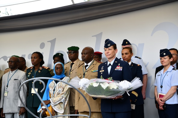 U.S. Air Force Col. Krystal Murphy, Deputy Command Surgeon for U.S. Africa Command, prepares to place a bouquet of flowers on a memorial during a visit to the Kigali Genocide Memorial in Kigali, Rwanda on May 22, 2019. Participants who attended the African Partner Outbreak Response Alliance (APORA) conference got an opportunity to visit the memorial for an afternoon. During APORA, military and civilian leaders worked together to align best practices and improve response capabilities for potential outbreaks of contagious diseases. The training bolstered relationships with current partners and mobilize new partners to strengthen pandemic prevention programs. (U.S. Air Force photo by Master Sgt. Andy M. Kin)