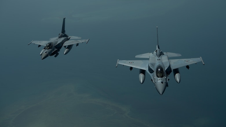 A photo of two UAE aircraft
