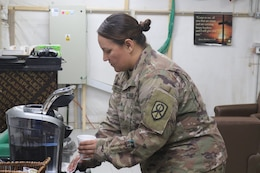 Sgt. Ruthie Huddleston, 450th Transportation Battalion, prepares a cup of coffee at Holy Joe's, a resiliency center at Camp Arifjan, Kuwait, May 20, 2019.