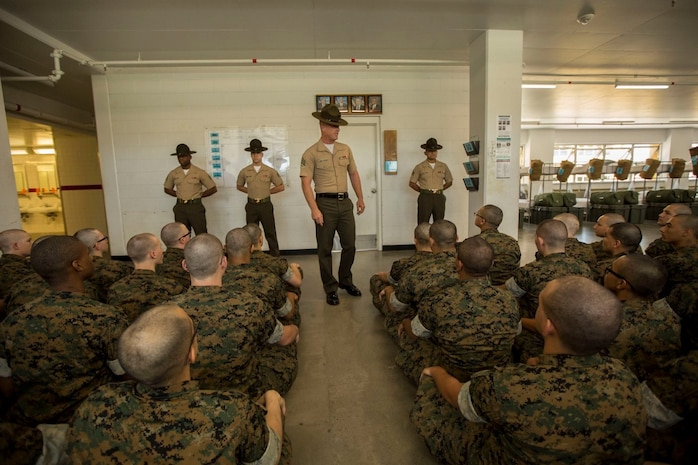 Drill instructors with India Company, 3rd Recruit Training Battalion, recite the Drill Instructor Creed during pick up at Marine Corps Recruit Depot San Diego, May 17.