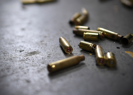 Empty shell casings scatter the ground of the shooting range May 16, 2019, on Grand Forks Air Force Base, North Dakota. The rounds were used during an excellence-in-competition shooting match, which was open to all active duty members on Grand Forks AFB. (U.S. Air Force photo by Senior Airman Elora J. Martinez)