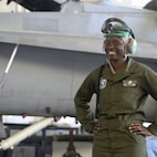 Cpl. Kylaine Rogers poses for a photo in front of an aircraft in Marine Fighter Attack Squadron-115's hangar aboard Marine Corps Air Station Beaufort, May 29. Rogers is an avionics technician with VMFA-115.
