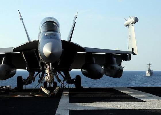 A U.S. Navy EA-18G Growler aircraft attached to Electronic Attack Squadron 141 sits on the flight deck of USS George H.W. Bush (CVN 77) Oct. 13, 2010, while under way in the Atlantic Ocean for a tailored ship's training availability/final evaluation period. The training was designed to tensure the ship was ready for deployment. (DoD photo by Naval Aircrewman 3rd Class Joshua K. Horton, U.S. Navy/Released)