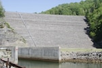 Gathright Dam in Alleghany County, Virginia, impounds water flowing down the Jackson River to create the 2,500-acre Lake Moomaw. Since opening in 1979, the dam has prevented numerous floods, saving countless dollars and lives. (U.S. Army photo/Vince Little)