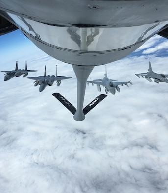 U.S. Air Force F-15 Eagles from 104th Fighter Wing, Barnes Air National Guard Base, Mass., form up next to Royal Danish Air Force F-16 Falcons behind a KC-135 Stratotanker from Joint Base McGuire-Dix-Lakehurst, N.J., after receiving fuel over Sweden, May 24, 2019.  The aircraft are supporting Arctic Challenge Exercise 19, a Nordic aviation exercise intended to provide scenario-based training to prepare partner forces for enemy defensive systems. (U.S. Air Force photo by Staff Sgt. Kenneth Shaner Brown)