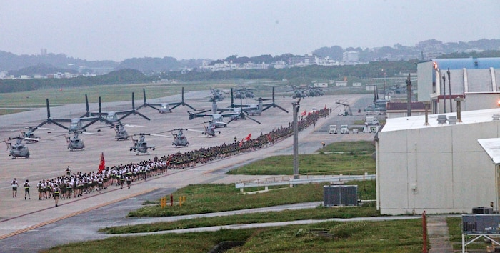 Marines with 1st Marine Aircraft Wing participate in a formation run at Marine Corps Air Station Futenma, Okinawa, Japan, May 28, 2019. Over 1,000 Marines and Sailors attended a 3 mile run around the air station flight line in order to review, refocus and recommit Marines to the mission after Memorial Day. As the aviation combat element of III Marine Expeditionary Force, 1st MAW Marines and Sailors must have the physical and mental endurance to advance in environments of extreme hardship, complexity, and pressure to perform. Motivational runs prepare 1st MAW service members to remain healthy and sustain the criteria for deployment, retention, and continued military service.
