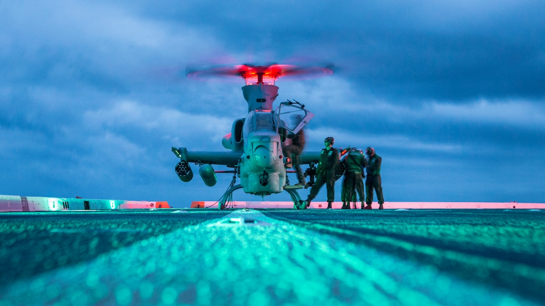 U.S. Marines with Marine Medium Tiltrotor Squadron 163, 11th Marine Expeditionary Unit, swap pilots for an AH-1Z Viper aboard the San Antonio-class amphibious transport dock ship USS John P. Murtha. The Marines and Sailors of the 11th MEU are deployed to the U.S. 7th Fleet area of operations to support regional stability, reassure partners and allies, and maintain a presence postured to respond to any crisis ranging from humanitarian assistance to contingency operations.