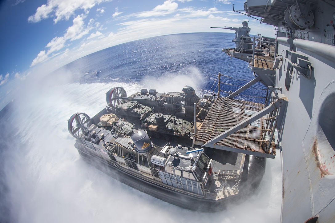 A landing craft, air cushion with Assault Craft Unit 5, departs the amphibious assault ship USS Boxer transporting light armored vehicles with Battalion Landing Team 3/5, 11th Marine Expeditionary Unit, during training operations. The Marines and Sailors of the 11th MEU are deployed to the U.S. 7th Fleet area of operations to support regional stability, reassure partners and allies, and maintain a presence postured to respond to any crisis ranging from humanitarian assistance to contingency operations.