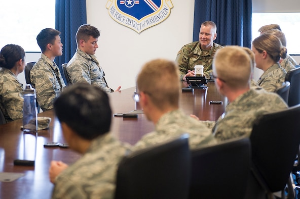 Maj. Gen. James A. Jacobson, Air Force District of Washington commander, listens to questions from ROTC Cadets from universities across the country at Joint Base Andrews, Md., May 22, 2019. Jacobson gave leadership insights, answered questions and discussed how important innovative Airmen are for the future of the Air Force. (U.S. Air Force photo by Master Sgt. Michael B. Keller)