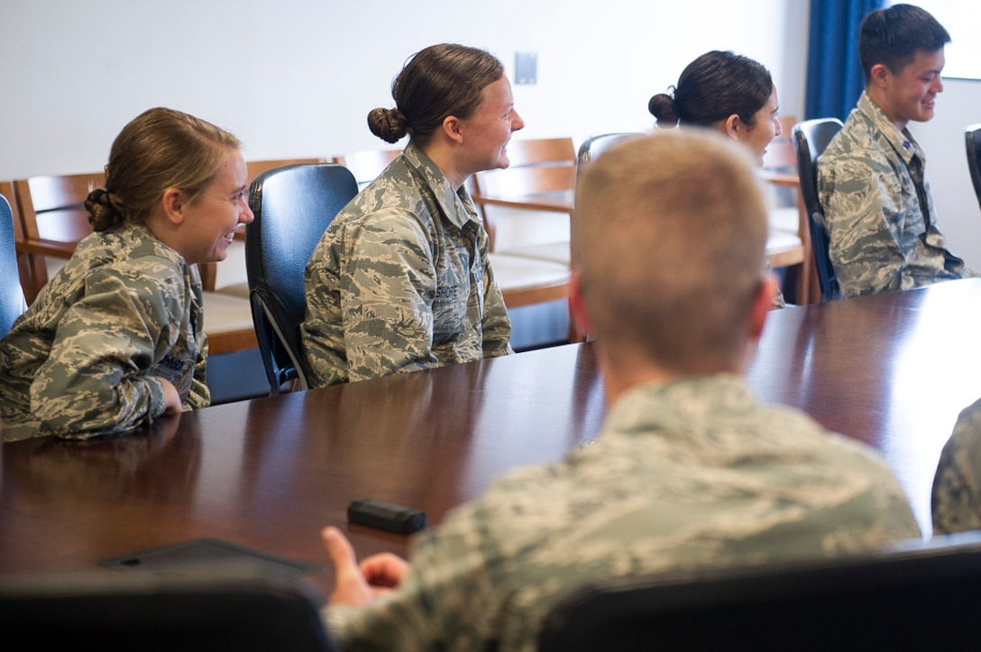 ROTC Cadets from universities across the country laugh during a discussion with Maj. Gen. James A. Jacobson, Air Force District of Washington commander, at Joint Base Andrews, Md., May 22, 2019. The cadets had a chance to sit down with Jacobson during a stop while touring the Washington area. (U.S. Air Force photo by Master Sgt. Michael B. Keller)