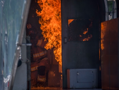 A firefighter assigned to the 628th Civil Engineer Squadron puts out a fire in a mobile aircraft fire training unit May 27, 2019, at Joint Base Charleston, S.C.